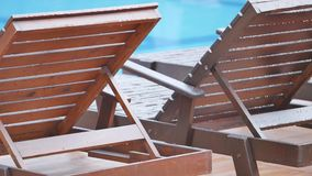 Wooden lounger on the beach.  stock video