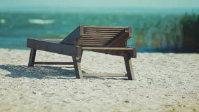 Wooden lounger on the beach stock video footage