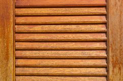Wooden louver windows background Stock Photos