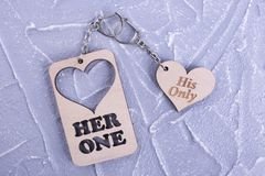 Wooden love key chain. Keychain for him and for her. Twin keychain for Valentine`s Day royalty free stock image