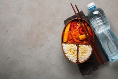 Wooden lunch boxe with healthy food ready to go for work or school, ahead meal preparation or dieting concept. On a old Stock Photo