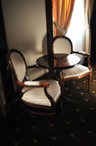 Wooden vintage chairs. Wooden vintage luxury chairs inside hotel room Royalty Free Stock Photography