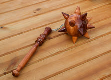 Wooden mace with chain. Lies on the floor drevyannom Stock Images