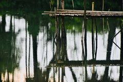Wooden made structure on top of a pond stock photography