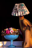 Wooden Madonna lamp with flowers Stock Photo