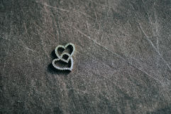 Wooden magic amulet in the shape of heart. Selective focus. Stock Photo