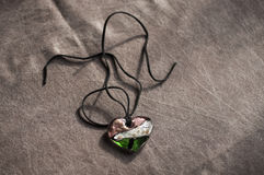 Wooden magic amulet in the shape of heart. Selective focus. Royalty Free Stock Photos