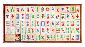 Wooden mahjong game tiles in box isolated on white Royalty Free Stock Photo