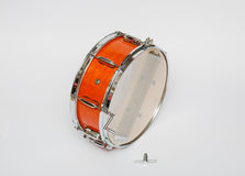Wooden mahogany color snare drum isolated on light grey background Stock Photography