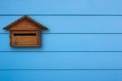 Wooden mail box and shera plank wall blue. Royalty Free Stock Photo