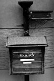 Wooden mailbox in black and white Stock Photo