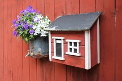 Wooden mailbox in the form of the Scandinavian lodge royalty free stock images
