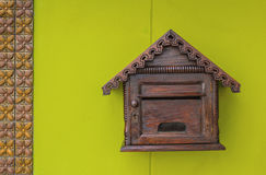 Wooden mailbox. Hang on the colorful wall Stock Photo