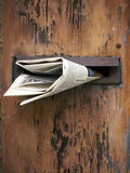Wooden mailbox with newspaper stock photos
