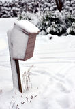 Wooden mailbox in winter Royalty Free Stock Images