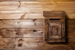 Wooden mailbox on wood wall background royalty free stock images