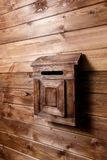 Wooden mailbox on wood wall background royalty free stock photos