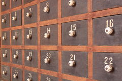 Wooden mailboxes. Old wooden mailboxes with numbers Royalty Free Stock Photo