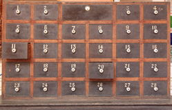 Wooden mailboxes. Old wooden mailboxes with numbers Royalty Free Stock Image