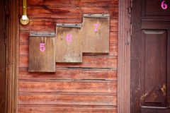 Wooden mailboxes on a wall Stock Images