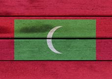 Wooden Maldives flag. Illustration of Maldives flag over a wood surface Royalty Free Stock Photo