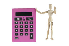 Wooden male model with calculator Royalty Free Stock Image