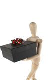 Wooden male model with gift Royalty Free Stock Images