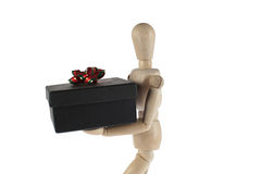 Wooden male model with gift Stock Images