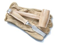Wooden mallet and chisel on leather gloves isolated white stock photos
