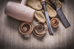 Wooden mallet curled up shavings firmer chisels leather gloves o Stock Photography