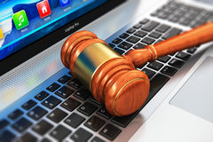 Wooden mallet on laptop keyboard Stock Image