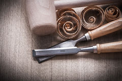 Wooden mallet scobs firmer chisels on wood surface horizontal vi Royalty Free Stock Photos