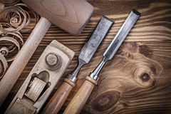 Wooden mallet shaving plane firmer chisels planning chips on vin Stock Photography