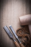 Wooden mallet shavings carpenter's firmer chisels on wood surf Stock Photos