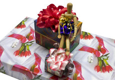 Wooden man. A wooden man gets gifts on the hips Stock Photography