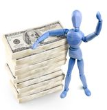 Wooden man & american currency. Royalty Free Stock Photos