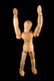 Wooden man with arms raised. A wooden man with his arms raised Royalty Free Stock Photo