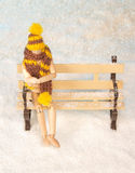 Wooden man on bench Royalty Free Stock Photography