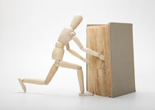Wooden man and book Stock Photography