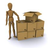 The wooden man and cardboard boxes Stock Photography