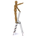 The wooden man climbed to the top of a stepladder Royalty Free Stock Images