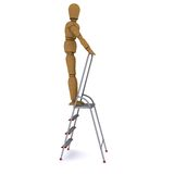 The wooden man climbed to the top of a stepladder Stock Images