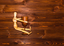 Wooden man with glass of wine Stock Photography