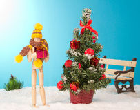 Wooden man holding a Christmas gift Stock Image
