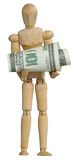 Wooden man holding dollars Stock Image