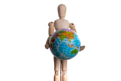 Wooden man holding a globe Stock Photography