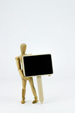 Wooden man holding a sign. Wooden man with sign in front of white background Royalty Free Stock Images