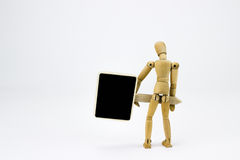 Wooden man holding a sign Stock Photography