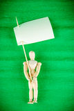 Wooden man holds flag, space for text Royalty Free Stock Photography