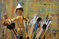 Wooden man with paintbrush Stock Image